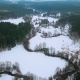 Beautiful Aerial View of River and Forest in Winter. Meandring Cold River in the Middle of Forest - VideoHive Item for Sale
