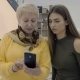 Two Women Look Photos at Smartphone in Photo Studio - VideoHive Item for Sale