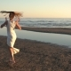 Young Woman in White Dress Dancing on Beach - VideoHive Item for Sale