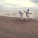 Two Men Practicing Capoeira on Beach - VideoHive Item for Sale