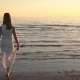 Back View of Young Woman Walking on Water - VideoHive Item for Sale