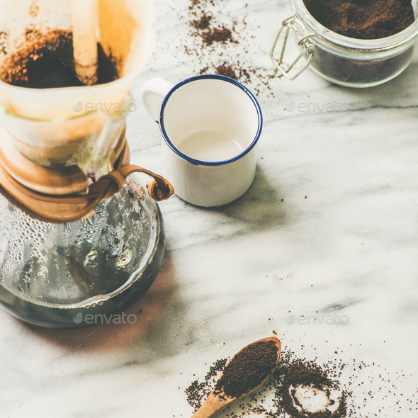 Black filtered coffee in flask and white cup, square crop - Stock Photo - Images