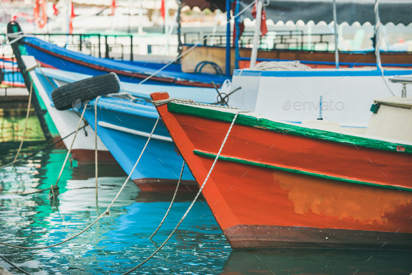 Colorful fishermens boats in small Mediterranean town - Stock Photo - Images