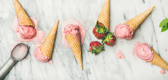 Flat-lay of homemade yogurt strawberry ice cream over marble background - Stock Photo - Images
