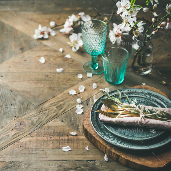 Spring Easter Table setting over vintage wooden background, square crop - Stock Photo - Images