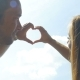 Couple in Love Making Heart Shape with Hands - VideoHive Item for Sale