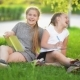Two Funny Girls Are Playing with Books - VideoHive Item for Sale