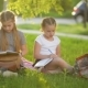 Girls Doing Homework in the Summer Garden. They Are Having a Lot of Fun Getting Knowledge. - VideoHive Item for Sale