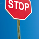 Stop sign blue sky background - PhotoDune Item for Sale
