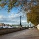 of People Walking Along the Embankment of the River Thames. Autumn. The Yellow Leaves Fall Off - VideoHive Item for Sale