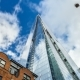 Looking Up The Shard, Blue Sky and Сumulus Clouds Reflected in the Glass. London, UK. - VideoHive Item for Sale