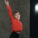 Female Dancer in Red Sweater Dancing Under the Drops of Water in the Studio Before Studio Light - VideoHive Item for Sale