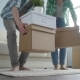 Happy Young Couple with Cardboard Boxes Moves to New Apartment - VideoHive Item for Sale