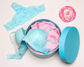Close-up of open round gift box with blue lingerie set - PhotoDune Item for Sale