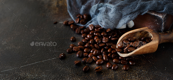 Coffee beans and a wooden spoon  on a dark background - Stock Photo - Images