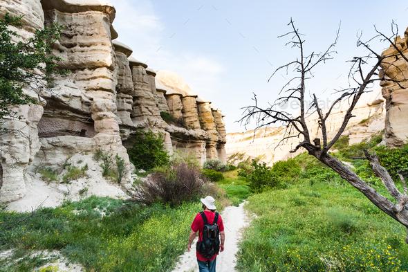 tourist walks in ravine near Goreme in Cappadocia - Stock Photo - Images