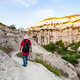 ourist on rock slope in gorge near Goreme town - PhotoDune Item for Sale