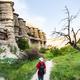 tourist walks in ravine near Goreme in Cappadocia - PhotoDune Item for Sale