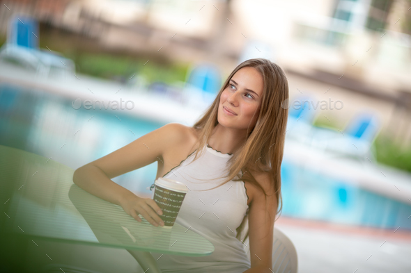 Pretty girl in outdoors cafe - Stock Photo - Images