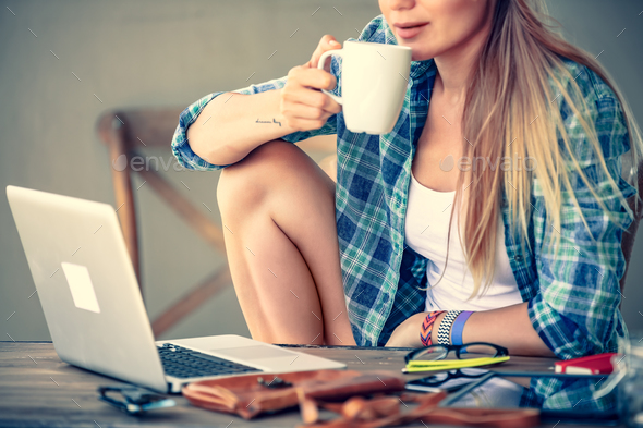 Student girl drinking coffee - Stock Photo - Images