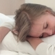Relaxed Young Blonde Girl Sleeping on White Bed at Home or in Hotel Room - VideoHive Item for Sale