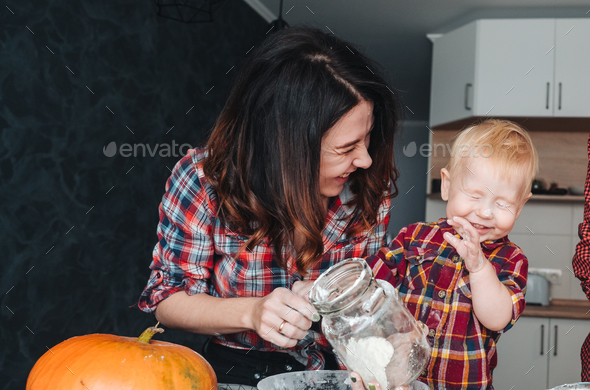Mom and little son in the kitchen - Stock Photo - Images