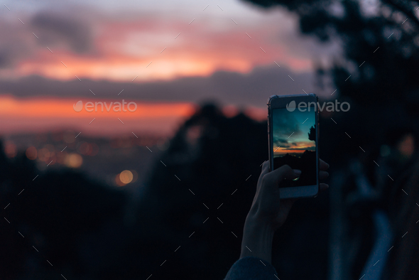 Young woman taking photo - Stock Photo - Images