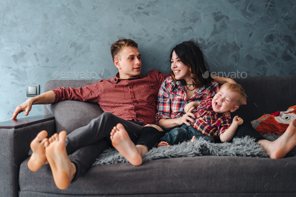 Happy family on the couch - Stock Photo - Images
