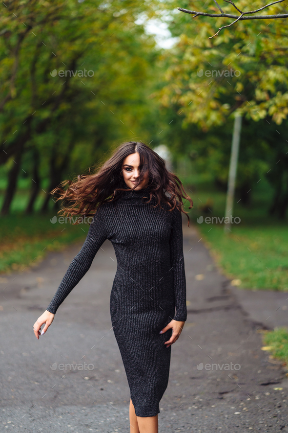 Outdoor portrait of young pretty beautiful calm woman - Stock Photo - Images