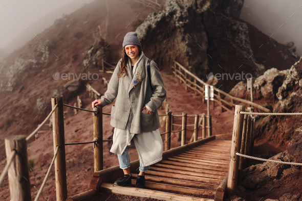 Girl climbs the path to the mountain - Stock Photo - Images