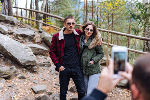 guy and girl are posing on camera - Stock Photo - Images