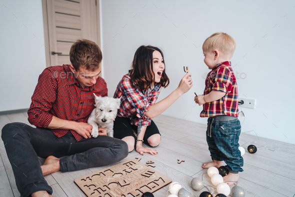 Happy family are playing together on the floor - Stock Photo - Images