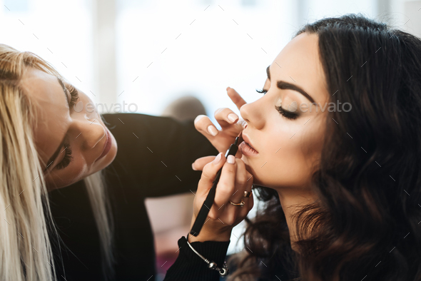 Makeup and hairstyle for a beautiful model - Stock Photo - Images