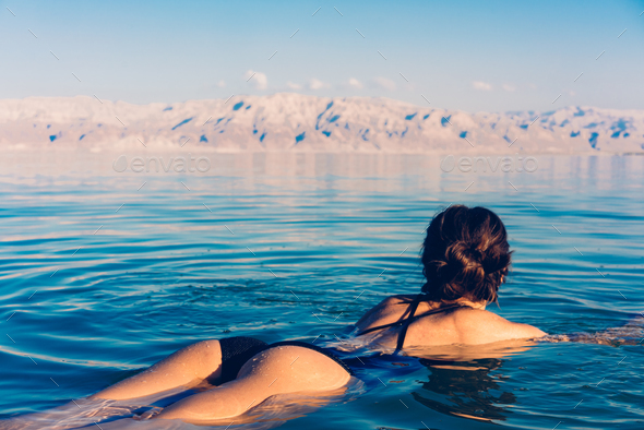 Girl is relaxing and swimming in the water - Stock Photo - Images