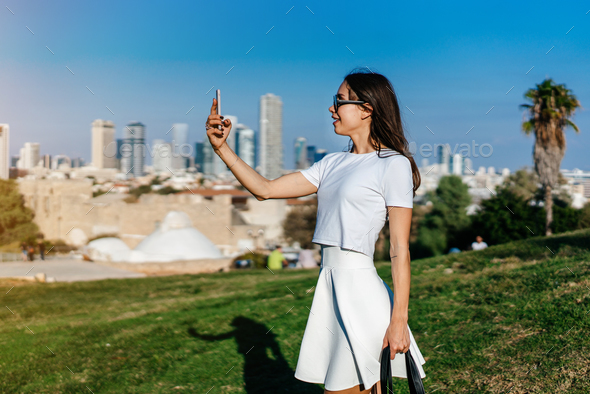 Young attractive woman taking selfie - Stock Photo - Images