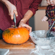 Dad cuts a pumpkin for a pie - PhotoDune Item for Sale