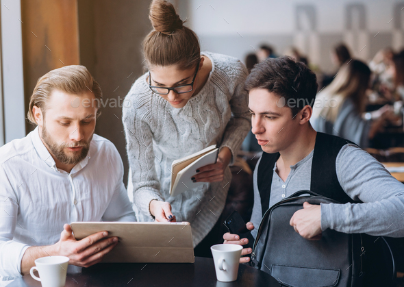 Three Businesspeople Working In cafe - Stock Photo - Images