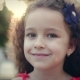 Beautiful Little Girl Spinning in Park and Smiling. Stock Footage. - VideoHive Item for Sale
