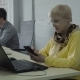 Retired Woman Use Her Phone in Office During the Work - VideoHive Item for Sale