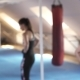 Beautiful Woman After a Hard Workout Enters the Frame and Looks Directly Into the Camera - VideoHive Item for Sale