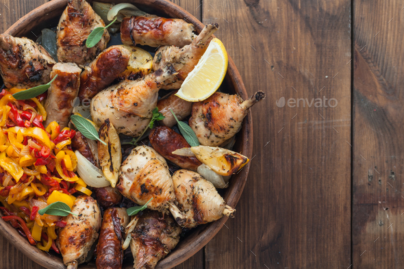 Closeview roasted chicken legs with sausages, sage and lemon. Top view. Copyspace - Stock Photo - Images