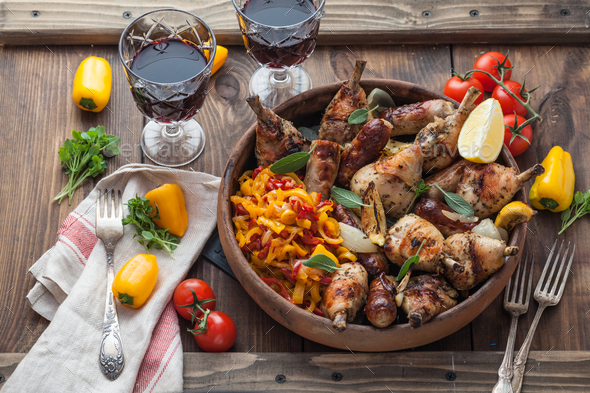 Spicy baked chicken with sausages, sage and lemon. Top view. - Stock Photo - Images