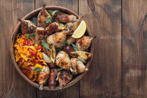 Baked chicken legs with sausages, sage and lemon. Top view. Copyspace - Stock Photo - Images