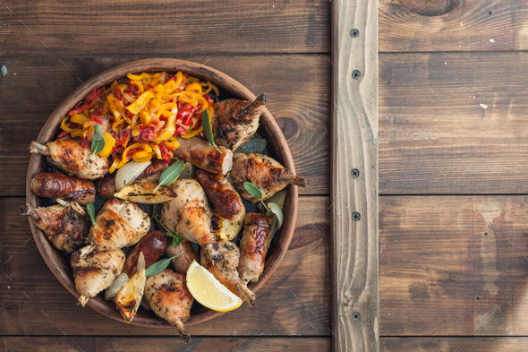 Baked chicken with sausages, sage and lemon. Top view. Copyspace. - Stock Photo - Images
