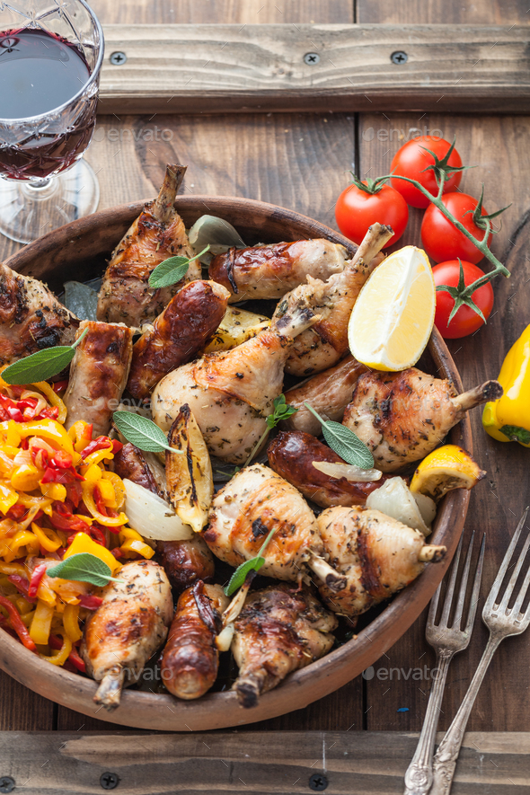 Roasted chicken legs with wine on a plate - Stock Photo - Images