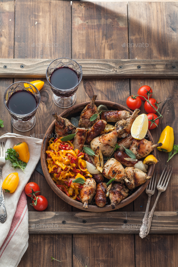 Baked chicken with sausages, sage and lemon. Top view. - Stock Photo - Images