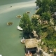 Bungalows with Thatched Roof and Wooden Pier for Boats on Shore Green Lake in Luxury Mountain Hotel - VideoHive Item for Sale