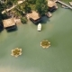 Summer Bungalows with Thatched Roof and Boat Pier on Shore Green Lake in Luxury Mountain Hotel - VideoHive Item for Sale