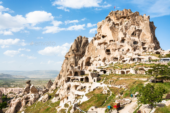 rock-cut Uchisar castle in Cappadocia in spring - Stock Photo - Images