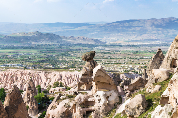 fairy chimney rocks in Uchisar town and valley - Stock Photo - Images